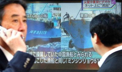 A man compares a YouTube video with released footage of a collision in the East China Sea in 2010. To Japan's credit, the internet is far freer in Japan than in its Northeast Asian neighbours China and South Korea. (Photo: AAP)