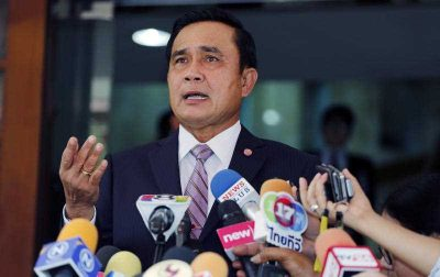 Thai Prime Minister Prayuth Chan-ocha talks to reporters on the anniversary of the military coup at Government house in Bangkok, Thailand. (Photo: AAP)