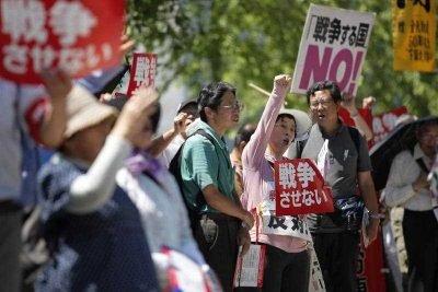 Demonstrators shout while holding banners reading 'No War' during a protest against reforms that would allow Japan to dispatch its Self-Defense Forces overseas, on 26 May 2015. (Photo: AAP)