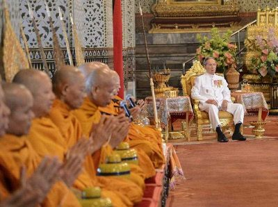 A Royal Household Bureau handout photo shows Thai King Bhumibol Adulyadej, 87, sitting as Buddhist monks chant during his coronation anniversary ceremony at the Amarin Winitchai Throne Hall inside the Grand Palace in Bangkok, Thailand, 5 May 2015. (Photo: AAP).