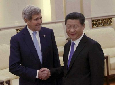 US Secretary of State John Kerry shakes hands with Chinese President Xi Jinping in Beijing, China, May 17, 2015. Tensions are growing between the U.S. and China over suspicions that Beijing was behind the biggest cyber breach of federal personnel records. (Photo: AAP)