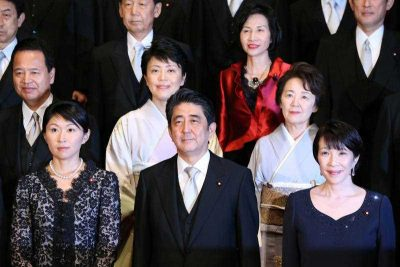 Japanese Prime Minister Shinzo Abe poses with his new female Cabinet Ministers (clockwise), Yuko Obuchi, minister of economy, trade and industry, Haruko Arimura, minister in charge of supporting women's empowerment, Midori Matsushima, minister of justice, Eriko Yamatani, chair of the National Public Safety Commission and minister in charge of the abduction issue, and Sanae Takaichi, minister of internal affairs and communications, in Tokyo on 3 September 2014. (Photo: AAP)