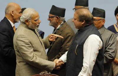 Indian Prime Minister Narendra Modi (2L) shakes hands with Pakistan's Prime Minister Nawaz Sharif (2R) during the closing session of the 18th SAARC summit at City Hall in the Nepalese capital Kathmandu on 27 November 2014. (Photo: AAP)
