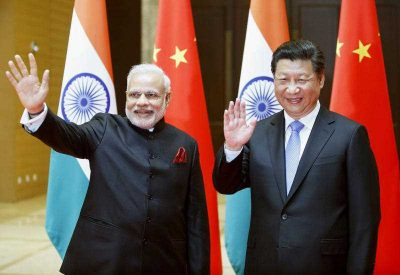 India's Prime Minister Narendra Modi (L) and China's President Xi Jinping wave to the press before their meeting in Xian, the capital of the Chinese Shaanxi Province, on 14 May 2015. (Photo: AAP)