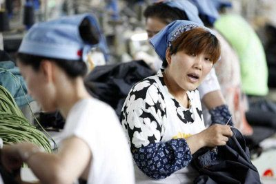 Female Chinese workers sew clothes at a garment factory in Huaibei city, east China's Anhui province, 1 June 2015. Studies suggest that one-quarter of Chinese growth over the past three decades has been the result of its demography. (Photo: AAP)