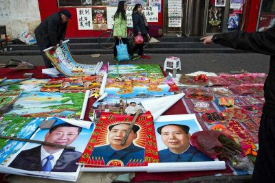 Vendors sell posters of Chinese President Xi Jinping and Communist Party founder Mao Zedong on a street of Gujiao in northern China's Shanxi province.  (Photo: AAP)