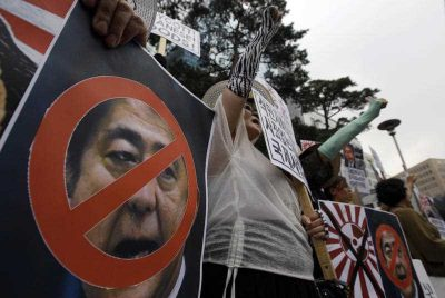 South Korean protesters and North Korean defectors shout slogans during a rally denouncing Japanese Prime Minister Shinzo Abe's statement to mark the 70th anniversary of the end of World War II, near the Japanese Embassy in Seoul, South Korea, Saturday, Aug. 15, 2015. (Photo: AAP)