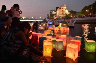 Paper lanterns float on the Motoyasu River in front of the Atomic Bomb Dome in Hiroshima on August 6, 2015 (Photo: AAP)