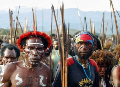 Papuan people participate in a march to commemorate the UN's International Day of the World's Indigenous People in Wamena on 9 August, 2008. For a period of time PNPM-RESPEK was the only program reaching native Papuans in remote rural areas. (Photo: AAP)