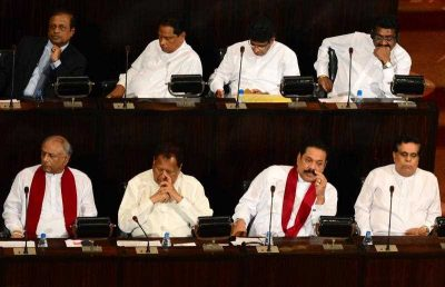 Former Sri Lankan president and Member of Parliament Mahinda Rajapakse (2R, Bottom) attends the inauguration of parliament in Colombo on September 1, 2015. Rajapakse failed to stage a comeback as prime minister at August 17 elections after losing the January 8, 2015 presidential election after a decade in power. (Photo: AAP)