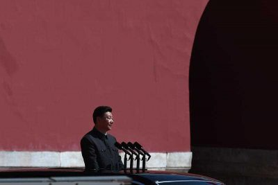 Chinese President Xi Jinping prepares to review People's Liberation Army troops from a car during a military parade to mark the 70th anniversary of Japan's surrender during World War II. (Photo: AAP).