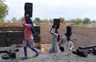 Indian labourers work at a brick manufacturing unit on the outskirts of Hyderabad on 2 March 2015. (Photo: AAP)