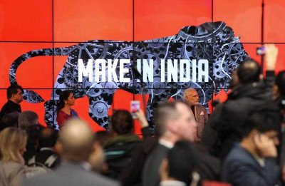 The words 'Make in India' are seen on a video wall as part of the campaign 'Make in India' which promotes the exhibition's partner country India at the Hannover Messe industrial trade fair in Hanover, Germany, 13 April 2015. (Photo: AAP)