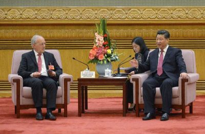 Chinese President Xi Jinping, right, speaks to Swiss Economy Minister Johann Schneider-Ammann as he meets with delegates attending the signing ceremony for the Articles of Agreement of the Asian Infrastructure Investment Bank (AIIB) at the Great Hall of the People in Beijing Monday, 29 June 2015. (Photo: AAP)