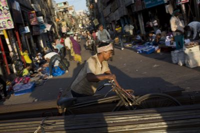 "An Indian laborer pulls a cart loaded with metal rods at a market in the morning in New Delhi, India, Wednesday, Sept. 30, 2015. ""In India, a tentative economic recovery is underway, but is still far from robust,"" Asia's third-largest economy 's central bank said in its policy statement (Photo: AAP)."