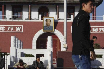 Residents walk past a replica of Tiananmen Gate in Yinchuan in northwestern China's Ningxia Hui autonomous region on 8 October 2015.  (Photo: AAP)