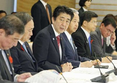 Japanese Prime Minister Shinzo Abe addresses the inaugural meeting at the government's headquarters on domestic measures for the Trans-Pacific Partnership trade initiative on October 9, 2015, in Tokyo. He vowed to implement measures to beef up the country's agricultural sector in the wake of the landmark free trade accord involving Japan, the United States and 10 other Pacific Rim countries. (Photo: AAP)