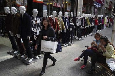 Shoppers walk past a row of mannequins at a shopping mall in Yinchuan in northwestern China's Ningxia Hui autonomous region on 11 October 2015. (Photo: AAP)
