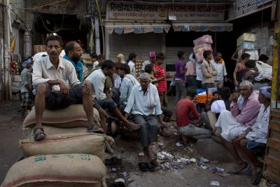 Indian labourers rest as others attend to their daily chores early morning in the Spice Market in New Delhi, India, Thursday, 15 October 2015. (Photo: AAP)