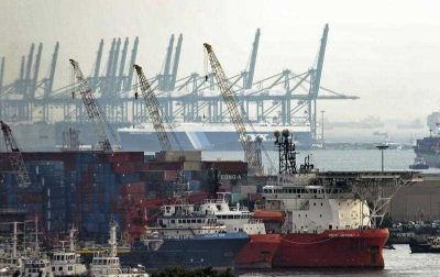 Ships and shipping containers in Jurong port in Singapore (Photo AAP)