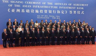Chinese President Xi Jinping poses for a group photo with delegates attending the signing ceremony for the Articles of Agreement of the Asian Infrastructure Investment Bank (AIIB) in Beijing, China, 29 June 2015. (Photo: AAP).
