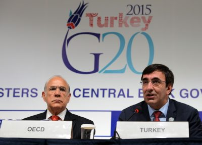 The Secretary-General of the Organization for Economic Cooperation and Development (OECD), Angel Gurria (L), and Turkish Deputy Prime Minister Cevdet Yilmaz, are pictured during a G-20 Governors' press conference at the IMF/World Bank Annual Meetings, in Lima, Peru, on October 9, 2015.  (Photo: AAP).