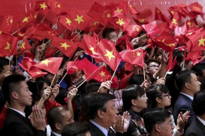 Vietnamese and Chinese communist youths wave flags to welcome Chinese President Xi Jinping and Vietnamese Communist Party General Secretary Nguyen Phu Trong at a meeting in Hanoi, Vietnam, Friday, Nov. 6, 2015.  (Photo: AAP)