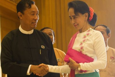 "Myanmar's parliamentary speaker Shwe Mann (L) and Chairperson of the National League for Democracy (NLD) Aung San Suu Kyi (R) shake hands before their meeting at Parliament in Naypyidaw on November 19, 2015. Suu Kyi is constitutionally barred from leading the country but has vowed to rule from ""above"" the next president, who she will select following her National League for Democracy's win in the November 8 polls (Photo: AAP)."