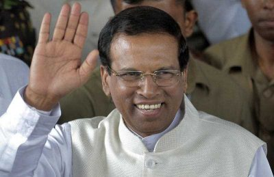 Sri Lankan President Maithripala Sirisena waves to supporters as he leaves the election secretariat in Colombo, Sri Lanka, 09 January 2015. (Photo: AAP).