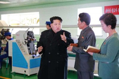 This undated picture, released from North Korea's Korean Central News Agency on 27 November 2015, shows North Korean leader Kim Jong-un inspecting the Wonsan shoe factory in Kangwon province, North Korea. (Photo: AAP).