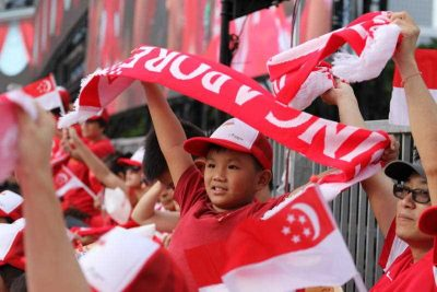 A young Singapore resident watches on during a military parade marking 50 years since independence at the Padang, Singapore on 9 August 2015. (Photo: AAP).