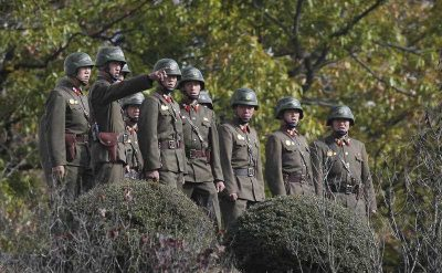 North Korean army solider look southern side as U.S. Defense Secretary Ash Carter visits at the border village of Panmunjom, which has separated the two Koreas since the Korean War, in Paju, South Korea, Sunday, Nov. 1, 2015. (Photo: AAP)