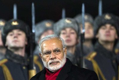 Indian Prime Minister Narendra Modi walks past a Russian honour guard on an official visit to President Vladimir Putin on 24 December 2015. (Photo: AAP)