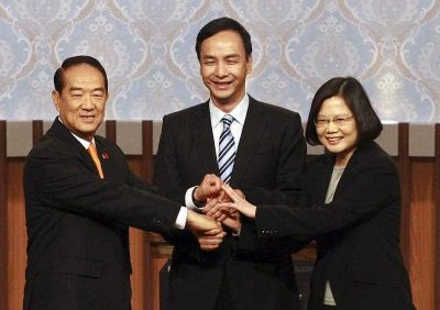 Taiwan's 2016 presidential election candidates People first Party's James Soong, KMT or Nationalist Party's Eric Chu and Democratic Progressive Party's (DPP) Tsai Ing-wen, shaking hands as they pose for a group photo at the start of their first televised policy debate in Taipei, Taiwan, 27 December 2015. (Photo: AAP).