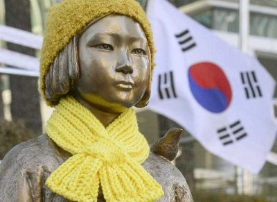 "A statue of a girl symbolising the issue of ""comfort women"" in front of the Japanese Embassy in Seoul. (Photo: AAP)"