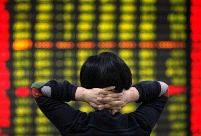 A Chinese investor monitors stock prices at a brokerage house in Huaibei in central China's Anhui province. (Photo: AAP)