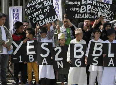 Filipino Muslims display placards during a rally at the Philippine Senate to coincide with the hearing at the Upper House on the passage of the Bangsamoro Basic Law (BBL) which would establish an autonomous region in the southern Philippines, 25 May 2015, Manila, Philippines.