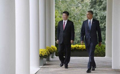 US President Barack Obama and Chinese president Xi Jinping walk the colonnade of the White House, Washington, DC, USA, 25 September 2015. (Photo: AAP).
