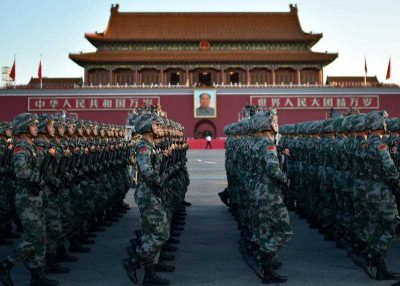 Chinese People's Liberation Army soldiers march during a military parade. (Photo: AAP)