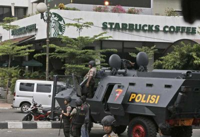 A police armoured vehicle is parked outside a Starbucks cafe following the attack in Jakarta, Indonesia, 14 January 2016. (Photo: AAP).