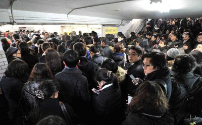 A crowd forms at the Keio Line's Chitose-Karasuyama Station in Setagaya Ward, Tokyo, 18 January 2016. (Photo: AAP).