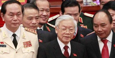 Vietnam's Communist Party General Secretary Nguyen Phu Trong stands next to Deputy Prime Minister Nguyen Xuan Phuc and Public Security Minister Tran Dai Quang while posing for a photo at the Closing Ceremony of the 12th National Congress of Vietnam Communist Party in Hanoi, Vietnam. (Photo: AAP)