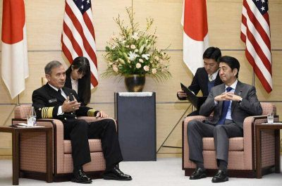 US Navy Admiral Harry B. Harris Jr., commander of the United States Pacific Command, with Japanese Prime Minister Shinzo Abe during a meeting in Tokyo on 16 February 2016. (Photo: AAP).