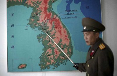 Korean People's Army Lt. Col. Nam Dong Ho points to a map showing the line which separates the two Koreas in Panmunjom at the Demilitarized Zone (DMZ) on 22 February 2016, in Panmunjom, North Korea. (Photo: AAP).