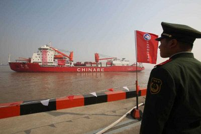 A Chinese paramilitary police officer stands guard as the Xue Long (Snow Dragon) icebreaker carrying Chinese scientists during their thirtieth Antarctic expedition leaves the polar expedition base dock in Shanghai, China, 7 November 2013. (Photo: AAP).