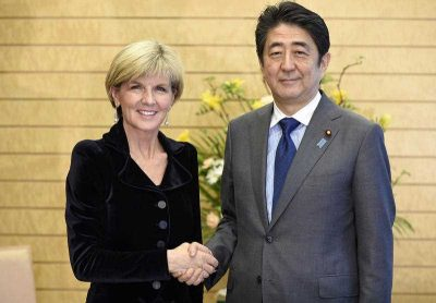 Australian Foreign Minister Julie Bishop shakes hands with Japanese Prime Minister Shinzo Abe prior to their meeting in Tokyo. (Photo: AAP)