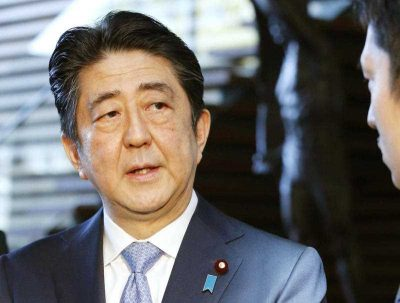 Japanese Prime Minister Shinzo Abe speaks to a reporter, 4 March 2016. (Photo: AAP).