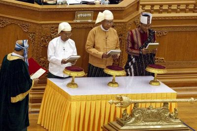 Myanmar President Htin Kyaw (C), and Myanmar Vice Presidents Myint Swe (L) and Henry Van Thio (R) are sworn in during the oath taking ceremony at the Union Parliament in Naypyitaw, Myanmar, 30 March 2016. (Photo: AAP).