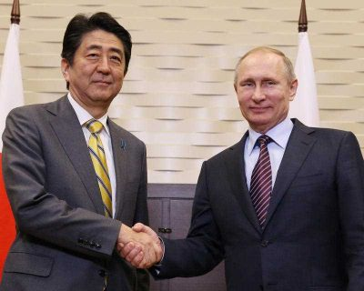 Shinzo Abe and Vladimir Putin shake hands prior to their meeting in Sochi, Russia, on 6 May 2016. (Photo: AAP)