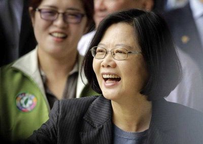 Taiwanese President Tsai Ing-wen smiles at supporters as she arrives to vote for party officials in Taipei, Taiwan, 22 May 2016. (Photo: AAP).